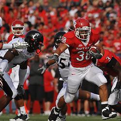 Sep 7, 2009; Piscataway, NJ, USA; Rutgers running back Joe Martinek (38) avoids tacklers during the first half of Rutgers game against Cincinnati in NCAA college football at Rutgers Stadium.