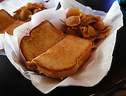 The Kaskaskia River House -- formerly known as Smitty's -- is still afloat and plans a whole new lineup of menu items under the new owners. The floating restaurant in New Athens had long been known as Smitty's but new owners Jeffrey Stahl, Stanley Sirtak and their spouses, are open for business following severe flooding which slowed down their plans. Shown is a Grown-Up Grilled Cheese sandwich that has both cheddar and provolone cheeses, tomato, bacon and fresh basil on Texas Toast. It's shown with a side of home-made potato chips. It sells for $7.99.