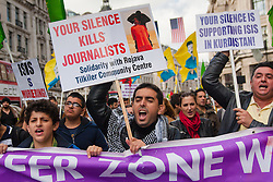 London, October 19th 2014. Hundreds of London's Kurdish community march throgh the capital in protest against ISIS and the Turkish government who they accuse, by not getting involved in military action against ISIS, of using the Jihadists to wipe out Kurds who have long been campaigning for an independent Kurdistan. PICTURED: Protesters chant slogans they march along Regents Street.