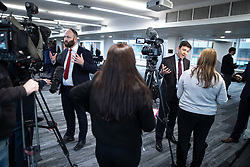 "© Licensed to London News Pictures. 07/01/2019. Manchester, UK. Mayor of Salford PAUL DENNETT and the Metro Mayor of Greater Manchester ANDY BURNHAM speak to media after announcing a revised plan for new housing (some on greenbelt land) , transport infrastructure , the reduction of pollution and improvements to the environment across the North West , alongside the regeneration of Stockport Town Centre , at an event at etc Venues in Manchester City Centre . The new "" Spatial Framework "" also reaffirms the region's commitment to ban fracking and lists 50,000 new "" affordable "" homes (30,000 of which are specified as social housing) . Photo credit: Joel Goodman/LNP"