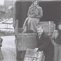 1. When was this photo taken?<br /> <br /> After World War II<br /> <br /> 2. Where was this photo taken?<br /> <br /> Germany, near Ravensburg<br /> <br /> 3. Who took this photo?<br /> <br /> Family or friend<br /> <br /> 4. What are we looking at here?<br /> <br /> Leaving for America.<br /> <br /> 5. How does this old photo make you feel? <br /> <br /> It reminds me how happy I was to start a new independent adventure.<br /> <br /> 6. Is this what you expected to see?<br /> <br /> No. I did not think anything would come of this roll of film. It has been exposed to the light for years. What a surprise. I almost fell out of my chair when I saw these images. Really a miracle.<br /> <br /> 7. What kind of memories does this photo bring back?<br /> <br /> I was leaving alone to America. Time for adventure away from my mother and siblings. I remember how excited I was for this new life ahead after World War II. Everyone is smiling but I remember they were in a shock that they were left behind.<br /> <br /> 8. How do you think others will respond to this photo?<br /> <br /> Surprised that there was such excitement and playful joy after such a tumultuous time, to start a new life.