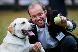 © Licensed to London News Pictures. 29/10/2015. London, UK. Conservative MP David Burrowes and his dog Cholmeley taking part at Westminster Dog of the Year competition in Victoria Tower Gardens in London on Thursday, 29 October 2015. Photo credit: Tolga Akmen/LNP