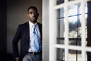 """HUNTSVILLE, AL – NOVEMBER 24, 2014: <br /> William Zonicle looks out the patio door of his single bedroom apartment while on lunch break. Zonicle, 23, graduated from Oakwood University in May 2014 with a bachelor's degree in healthcare administration, but good grades and a successful internship were not enough to help him land him a job in his field upon graduation. The recent unemployment rate among college graduates between 22 and 27 years old is rising much higher for African Americans than for their caucasian peers. In 2013, the jobless rate among blacks was 12.4 percent, compared to 4.9 percent among whites. """"It's been difficult,"""" Zonicle said, who has applied for at least 25 job openings in his field of healthcare finance or operations. """"I want to contribute to a thriving health system."""" In the meantime, Zonicle spends his days managing a university bookstore, making $7.60 an hour.  CREDIT: Bob Miller for The New York Times"""
