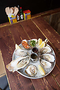 Seafood platter on wooden table in Temple Bar on 3rd April 2017 in Dublin, Republic of Ireland. Dublin is the largest city and capital of the Republic of Ireland.