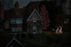 © Licensed to London News Pictures. 26/12/2016. Goring-, UK. As night falls Christmas lights still glow at George Michael's house in Goring. Pop superstar George Michael died on Christmas day at his Oxfordshire home on the River Thames aged 53. Photo credit: Peter Macdiarmid/LNP