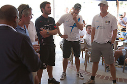 Adam Minoprio, Ben Ainslie, and Ian Williams, at the draw for the proposed sail-off after the repechage of the Argo Group Gold Cup 2010. Hamilton, Bermuda. 8 October 2010. Photo: Subzero Images/WMRT