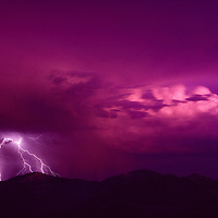 Lightning touches down through a sunset over California's White Mountains.