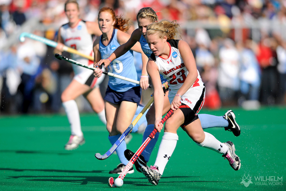 21 NOV 2010:  Harriet Tibble (23) of the University of Maryland advances the ball in front of Katie Ardrey (11) of the University of North Carolina during the 2010 NCAA Women's Division I Field Hockey Championship held on the campus of the University of Maryland in College Park, MD. Maryland defeated North Carolina 3-2 in double overtime to win the national title. © Brett Wilhelm