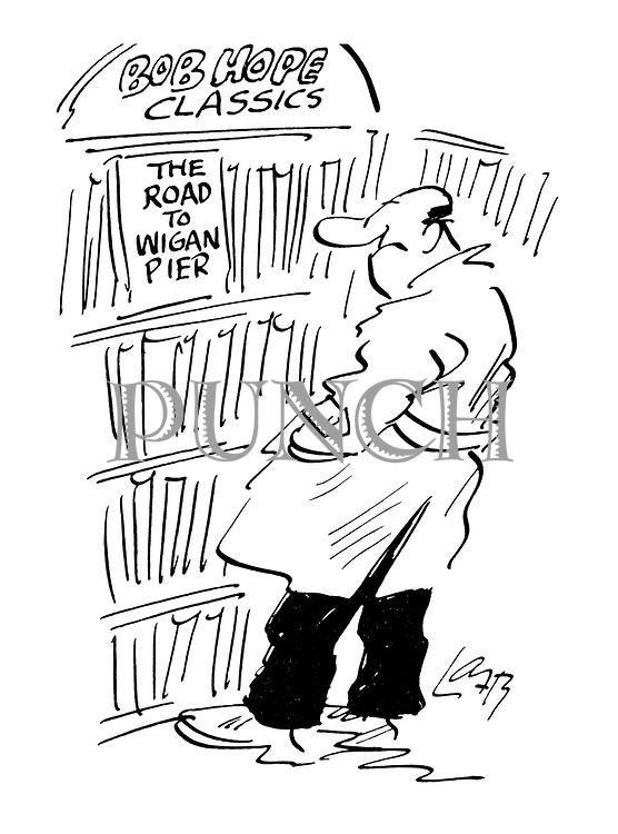 (A man in a bookshop looking at Bob Hope Classics: The Road to Wigan Pier)