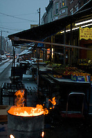 Fire, in a 55 gallon drum used to rid cardboard boxes and wood pallets, burns in the early morning at the Italian Market in Philadelphia, PA.