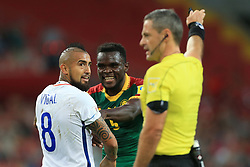 18th June 2017 - FIFA Confederations Cup (Group B) - Cameroon v Chile - Arturo Vidal of Chile jokes with Michael Ngadeu-Ngadjui of Cameroon - Photo: Simon Stacpoole / Offside.