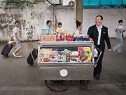A seller on the train platform. Life in the train from Hong Kong to Urumqi (Xinjiang).