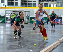 Robyn Pinder of WP Peninsula breaks down the left wing, chased by Robyn Dyer of KZN Inland during the interprovincial indoor hockey tournament held at the Bellville Velodrome, Cape Town, on the 13th October 2016. Photo by: John Tee/RealTime Images