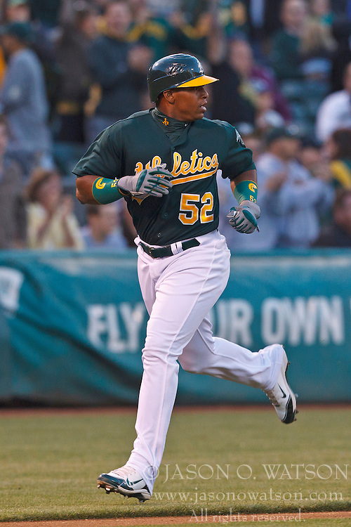 OAKLAND, CA - JUNE 20: Yoenis Cespedes #52 of the Oakland Athletics scores a run against the Los Angeles Dodgers during the fourth inning of an interleague game at O.co Coliseum on June 20, 2012 in Oakland, California. (Photo by Jason O. Watson/Getty Images) *** Local Caption *** Yoenis Cespedes