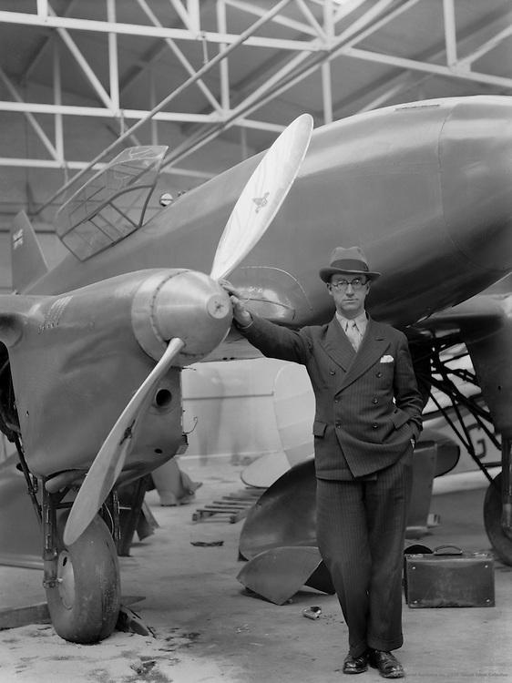 Man Leaning on the Propellor of an Aeroplane, De Havilland Aircraft Factory, England, 1935