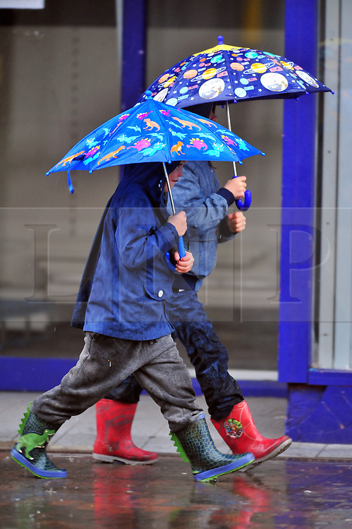 © Licensed to London News Pictures. 23/09/2018<br /> Orpington, UK.<br /> Heavy rain in South East London.<br /> Early Sunday morning wet weather in Orpington High Street, Orpington. <br /> Photo credit: Grant Falvey/LNP