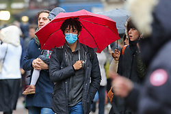 © Licensed to London News Pictures. 26/01/2020. London, UK.  A man in central London is seen wearing a face mask following the outbreak of Coronavirus in China which has killed 41 people. Photo credit: Dinendra Haria/LNP