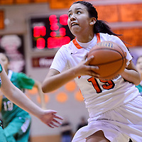 022715       Cable Hoover<br /> <br /> Gallup Bengal Tilea Reyna (15) makes a break past Farmington Scorpion Makayla Wood (42) during the district championship Friday at Gallup High School.