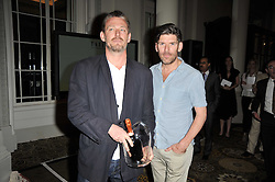 Left to right, RICHARD BEATTY and RUSSELL NORMAN the operators of London restaurants Polpo and Polpetto, at the Tatler Restaurant Awards 2011 held at the Langham Hotel, Portland Place, London on 9th May 2011.