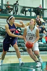 06 December 2017:  Maddie Merritt works in close under the basket against defender Hannah Frazier during an NCAA women's basketball game between the Wheaton Thunder and the Illinois Wesleyan Titans in Shirk Center, Bloomington IL