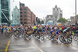 © Licensed to London News Pictures. 07/07/2014. London, UK. The crowd cheer the peloton near Tower Bridge during the Tour de France stage 3 in London. Photo credit : Vickie Flores/LNP