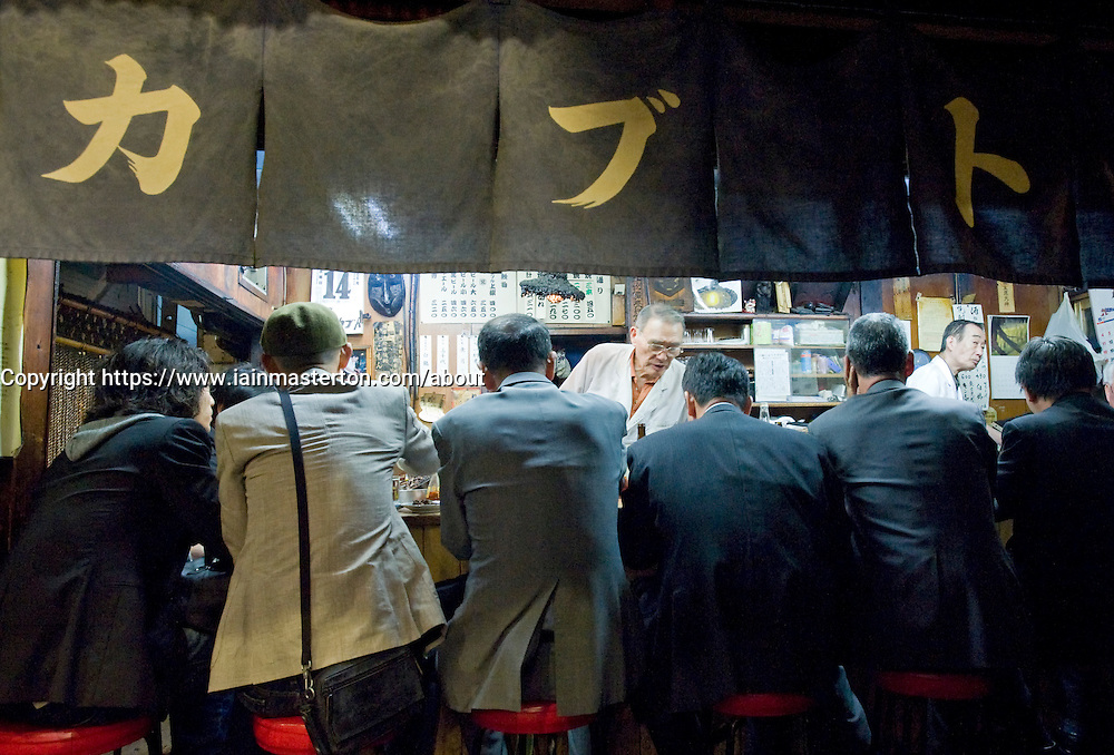 Typical busy yakitori restaurant or Izakaya at night in Shinjuku Tokyo Japan