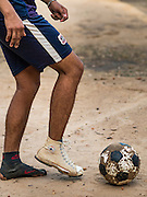 21 JUNE 2016 - DON KHONE, CHAMPASAK, LAOS: Boys play football (soccer) behind the old elementary school in Don Khone. Don Khone Island, one of the larger islands in the 4,000 Islands chain on the Mekong River in southern Laos. The island has become a backpacker hot spot, there are lots of guest houses and small restaurants on the north end of the island.       PHOTO BY JACK KURTZ