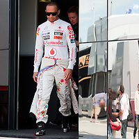 McLaren Formula One driver Lewis Hamilton of Britain wears a Kalocsa design outfit before the free practice of the Hungarian F1 Grand Prix in Mogyorod (about 20km north-east from Budapest), Hungary. Saturday, 30. July 2011. ATTILA VOLGYI<br /> Team sponsor Hugo Boss celebrates its 30th anniversary with special fan made designs for competition saturdays on all races. On Hungaroring the special design is from Hungarian folk tradition with motives from Kalocsa.