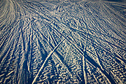 Crossing paths. Snowmobile tracks on frozen Lake Inari, Lapland, Finland