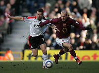 Photo: Lee Earle.<br /> Fulham v Arsenal. The Barclays Premiership. 04/03/2006. Fulham's Tomasz Radzinski (L) battles with Freddie Lungberg.