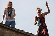 Housing activists take refuge on a rooftop from bailiffs trying to evict them from the Sweets Way housing estate on 23rd September 2015 in London, United Kingdom. A group of housing activists calling for better social housing provision in London had occupied some of the properties on the 142-home estate in Whetstone, in some cases refurbishing properties intentionally destroyed by the legal owners following eviction of the original residents, in order to try to prevent the eviction of the last resident on the estate and the planned demolition and redevelopment of the entire estate by Barnet Council and Annington Property Ltd.