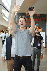 © Licensed to London News Pictures. 08/08/2015 <br /> Marcus Butler coming out to meet fans with his camera half way through his book signing.<br /> Blogger MARCUS BUTLER at Waterstones bookshop in Bluewater,Kent today meeting fans and signing copies of his book.<br /> (Byline:Grant Falvey/LNP)