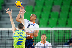 30-12-2019 SLO: Slovenia - Netherlands, Ljubljana<br /> Alen Pajenk of Slovenia and Fabian Plak of the Netherlands during friendly volleyball match between National Men teams of Slovenia and Netherlands