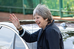 © Licensed to London News Pictures . 30/04/2018. Manchester , UK. British Prime Minister THERESA MAY waves to local residents after visiting Brooklands Primary School in Sale . May is facing questions over her role in the scandal of the way Windrush migrants have been treated and after the resignation of Home Secretary, Amber Rudd, late last night (29 April 2018) . Photo credit : Joel Goodman/LNP