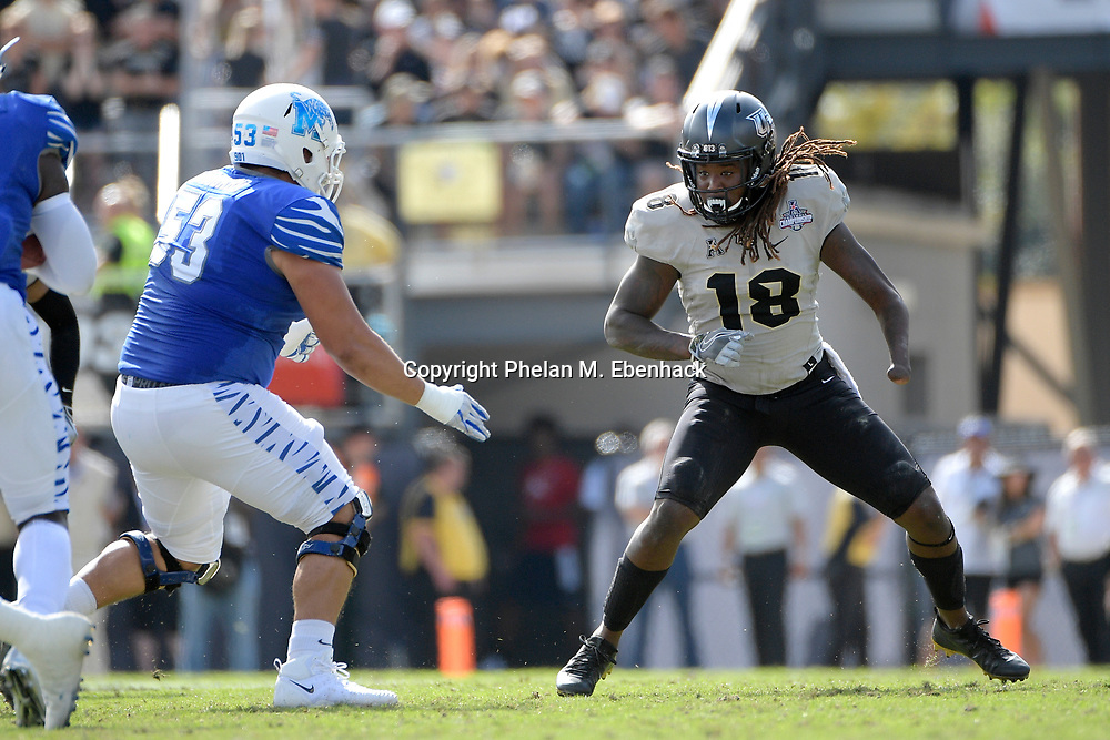 Central Florida linebacker Shaquem Griffin (18) is blocked by Memphis offensive lineman Dustin Woodard (53) during the first half of the American Athletic Conference championship NCAA college football game Saturday, Dec. 2, 2017, in Orlando, Fla. (Photo by Phelan M. Ebenhack)