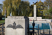 In memory of fallen WW2 Polish Air Force crews, are the front gates of Polish War Memorial, on 6th November 2019, in South Ruislip, Northolt, London, England. The Polish War Memorial is in memory of airmen from Poland who served in the Royal Air Force as part of the Polish contribution to World War II. The memorial was designed by Mieczyslaw Lubelski, who had been interned in a forced labour camp during the war. It is constructed from Portland stone with bronze lettering and a bronze eagle, the symbol of the Polish Air Force. The original intention was to record the names of all those Polish airmen who lost their lives while serving during WW2 (a total of 2,408) but there was not enough space for this and, as a compromise, the names of the 1,241 who died in operational sorties are there instead.