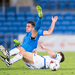 BRISBANE, AUSTRALIA - SEPTEMBER 20: Benjamin Lyvidikos of Gold Coast City is tackled by Luke Pavlou of South Melbourne during the Westfield FFA Cup Quarter Final match between Gold Coast City and South Melbourne on September 20, 2017 in Brisbane, Australia. (Photo by Gold Coast City FC / Patrick Kearney)