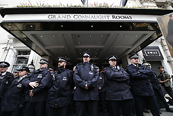 © Licensed to London News Pictures. 09/04/2016. London, UK. Police guard The Conservative Spring Conference as protestors calling for reform of UK tax laws protest. Photo credit: Peter Macdiarmid/LNP