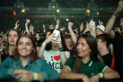 © Licensed to London News Pictures . 09/09/2017. Manchester , UK . The crowd cheer Rick Astley . We Are Manchester reopening charity concert at the Manchester Arena with performances by Manchester artists including  Noel Gallagher , Courteeners , Blossoms and the poet Tony Walsh . The Arena has been closed since 22nd May 2017 , after Salman Abedi's terrorist attack at an Ariana Grande concert killed 22 and injured 250 . Money raised will go towards the victims of the bombing . Photo credit: Joel Goodman/LNP