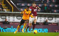 Football - 2020 / 2021 Premier League - Burnley vs Wolverhampton Wanderers - Turf Moor<br /> <br /> Nelson Seemed of Wolves and James Tarkowski of Burnley at Turf Moor <br /> <br /> <br /> COLORSPORT/LYNNE CAMERON
