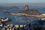 Sugarloaf Mountain and Guanabara Bay from Mirante Dona Marta in evening light in Rio de Janeiro, Brazil.