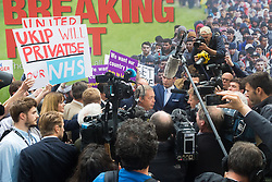 """Smith Square, Westminster, London, June 16th 2016. UKIP leader Nigel Farage launches his """"biggest ever"""" advertising campaign as Leave and Remain enter their last week of campaigning before the EU referendum on June 23rd. PICTURED: A Remain campaigner's poster declares that UKIP will privatise the NHS."""