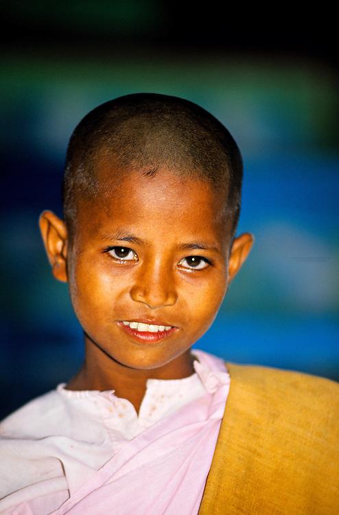 Young novice Buddhist nun, Sun U Ponya Shin Pagoda, atop Sagaing Hill, Sagaing, near Mandalay, Burma (Myanmar)