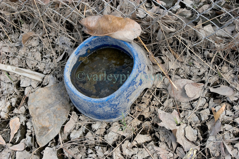 01 October, 05.  New Orleans, Louisiana. Lower 9th ward. Hurricane Katrina aftermath. <br /> The remnants of the lives of ordinary folks, now covered in mud as the flood waters recede.  A dog's bowl lies abandoned in the drying mud.<br /> Photo; ©Charlie Varley/varleypix.com