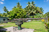 A remanent of World War II, a Japanese anti-aircraft gun sits in the tropical sun in a grassy field in Bogia, Madang Province, Papua New Guinea