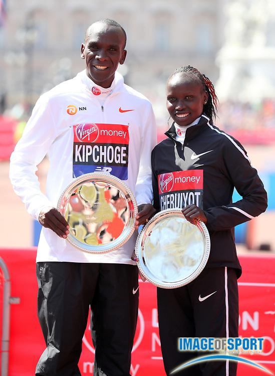 Eliud Kipchoge (KEN) and Vivian Cheruiyot (KEN) pose after winning the men's and women's race in the London Marathon in London, Sunday, April 22, 2018. (Jiro Mochizuki/Image of Sport)