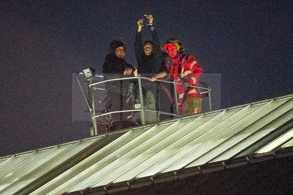 © Licensed to London News Pictures . 16/09/2015 . Manchester , UK . STUART HORNER ends his two and a half day protest on top of HMP Manchester (formerly Strangeways Prison ) shortly after 3am this morning (Wednesday 16th September 2015) . Photo credit : Joel Goodman/LNP