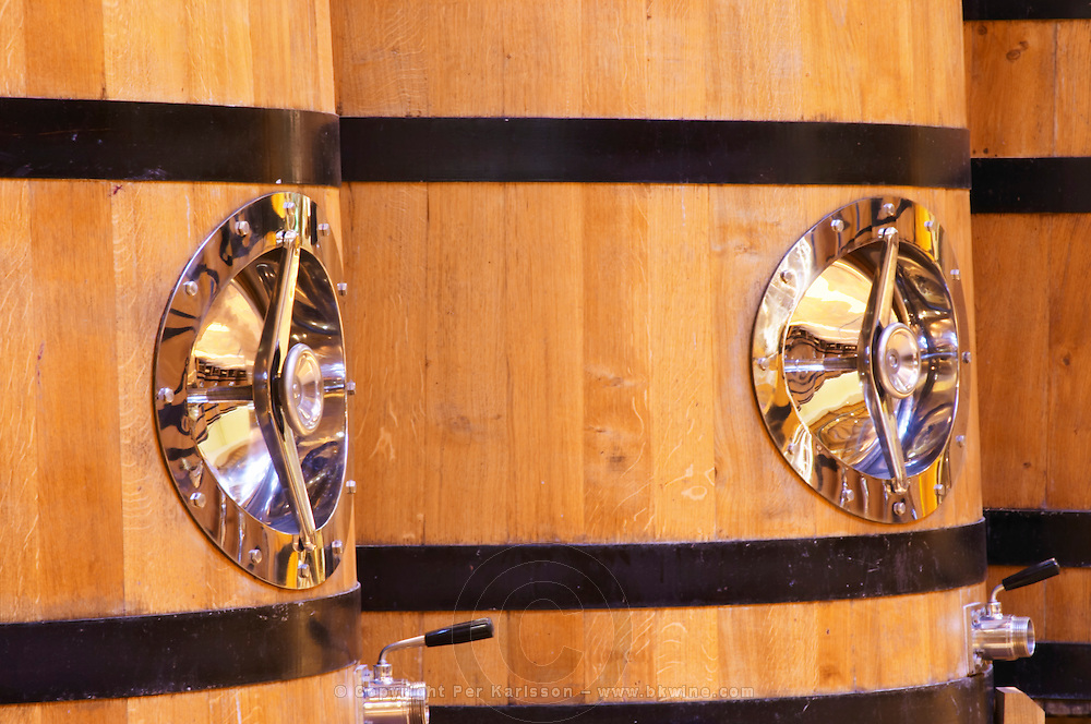 Detail of wooden fermentation tanks vats with a polished stainless steel door, Maison Louis Jadot, Beaune Côte Cote d Or Bourgogne Burgundy Burgundian France French Europe European
