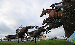 Aso ridden by Charlie Deutsch (blue colours) on their way to victory in the Download The Betbright App Handicap Chase during the New Year Meeting at Cheltenham Racecourse.