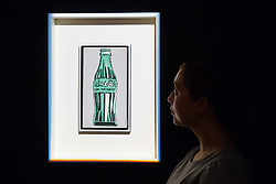 London, September 29 2017. A woman gazes at Andy Warhol's Coke Bottle, (1962) which is expected to fetch between £1.8-2.5 million at auction on October 3rd during Frieze Week at Christie's in London. Coke Bottle is the first branded object depicted by Warhol. © Paul Davey